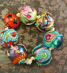 Flamey Amy Lampwork; aka TrorchByNight http://www.Flamekeeperbeads.com by Amy Kuczewski About: Her beads are in collections around the world, her fun and funky style giving color and bright happiness to jewelry worldwide... You may buy her art on this site as well as Etsy and Ebay to name but a few! I know I would burn myself and never be good at this! Thankfully we have Amy! Shop, support art and the open expression that is dares to share!