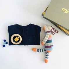 A very stylish gift set to celebrate the arrival of a new baby. * Zipped cotton romper with integrated scratch mitts and zip guard in Navy. * Organic cotton stripe bunny with built in rattle. Approx 30cm long. * Simple design beech wood teether ring with silicone parts. * All orders arrive beautifully gift wrapped in our Classic gift box (26x18x8cm). Re-use as a keepsake box. Romper A plain romper with zip through opening for easy changing morning and night, integrated scratch mitt cuffs… Cute Designs, Simple Designs, Organic Baby, Organic Cotton, Unique Baby Gifts, Baby Teethers, Baby Gift Sets, Baby Arrival, Newborn Baby Gifts