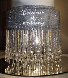 If you want a blinged-out wedding, this site, Decorate My Wedding, is chock-full of crystal wedding decorations of all kinds.  Bedecked, indeed!! Shown: Shawna Crystal Cake Stand