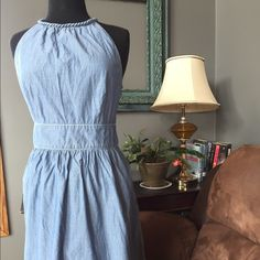 Chambray Tommy Hilfiger sundress Adorable chambray dress!  Worn twice.  One small flaw as shown in picture three.  Hardly noticeable.  Fun for those warm summer nights to show off those beautifully sun kissed shoulders!  Smoke free home.  Happy bidding! ☀️ Tommy Hilfiger Dresses Midi