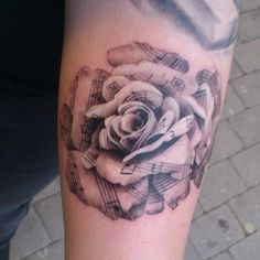Black and gray rose from note of sheets tattoo More