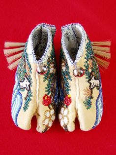 """Kame Baby Tabi""    Tsuru-Kame Baby Tabi-Moccasins     brain-tanned deer-hide, 13 cut beads, seed-beads, horse hair,  Tin-corns, and antique Japanese Kimono textiles"