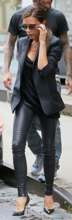 Victoria Beckham | Street Style. Wishing the outfit came w the 6ft tall accesory behind her