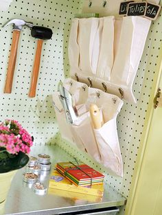 pegboard love.  Cut a canvas shoe organizer in two so that it doesn't dominate the pegboard.  BRILLIANT - couldn't figure out where I was going to hang my shoe organizer for crafty stuff!