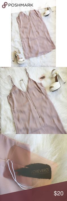 """F21 Light Purple Silky Knee Length Slip Dress ▪️Product Description▪️ ▫️Unique and oh-so eye-catching light purple silky dress  ▫️Adjustable straps & v-neck and back  ▫️Make it a combo dress with a t-shirt underneath  ▫️Super trendy instagrammer style   ▪️Fit: True small, rectangular cut for a flowy fit, roughly knee length depending on height  ▪️Condition: NWT  ▪️Measurements: Approx/Laying Flat  ▫️Length: 33""""  ▫️Bust: 16.5""""  ▫️Waist: 18"""" Forever 21 Dresses Midi"""