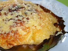 Philippines: Bibingka  ( Photo by Flickr user: Roberto Verzo )  Simbang Gabi (Night Mass) is the kick off to the Christmas season in the Philippines. The traditional celebration starts December 16, and includes nine days of masses before dawn. That may sound early, but after the people get to enjoy a special holiday breakfast complete with lots of sweet treats. Bibingka, a rice flour cake, is a popular Simbang Gabi dessert.    For a recipe, try this one from the blog The Kitchn .