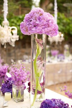 I love these purple centerpieces in the varying heights and shades of purple!