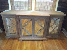 Reclaimed wood console.wood inlay, mirrored doors.