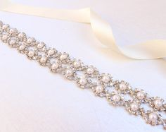 Welcome to my shop!  Discount code: GLCX03 ( 5% off more than $30)  GLCX10 ( 10% off more than $100 )  ~~~ Beautiful pearl wedding belt ~~~ Add a little sparkle to your wedding dress !  The total width of rhinestone part is about is about 0.8 (2 cm),double faced satin ribbon 0.6(1.5 cm) wide.each end of the rhinestone part through superior hand-stitching rather than gluing techniques. Each order will be boxed in a pretty keepsake box  Available in 5 sizes (select option in dropdown).  - 12…