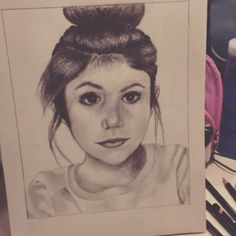Girl with a bun drawing