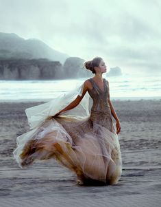 [gorgeous flowing dress at the beach]