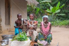 Congolese family in front of their house Lizenzfreies Foto