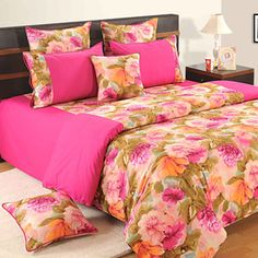 Double bedsheet or double bed comforter made with printed fabric depicting larger than life flower power matched with bright pink plain fabric. Rs 2218/-