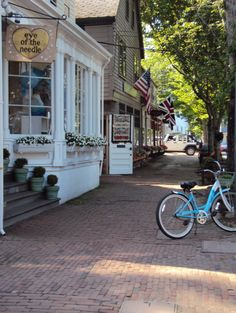 """Can't have a beautiful store front without an adorable blue bike! It just adds to the """"yesteryear"""" ambiance!"""