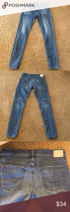 """AG Jeans The Nikki Relaxed Skinny Size 27R These jeans have a little wear around the front and back pockets and at the pant leg hem.  They are still in good condition.  Inseam approx 32.5"""" and waist laying flat is approx 15.5"""". AG Adriano Goldschmied Jeans Skinny"""