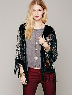 Sheer silk kimono style bed jacket with cut velvet in a floral stained glass inspired design and a solid stripe border. Knotted fringe trim. $116.00 by Free People