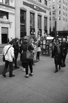 New York Street Photography. Tourists surrounded by skyscrapers. http://frank-romeo.artistwebsites.com/