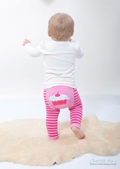 Striped raspberry and baby pink leggings, with a cupcake on the bottom. Available in 6 sizes.