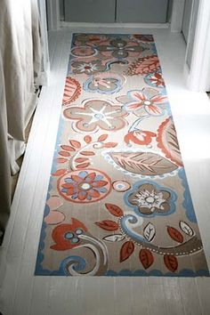 Nice twist on a painted floor -- a painted floor runner. See the step-by-step instructions here.