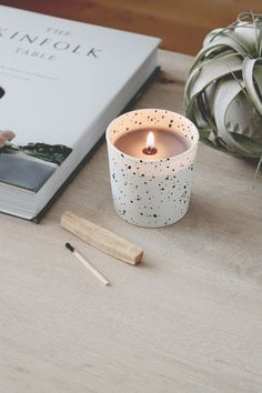 How cute are these speckled votives and how cool is the fact that they are made at home? All you ned is paint. Take a look. #DIY