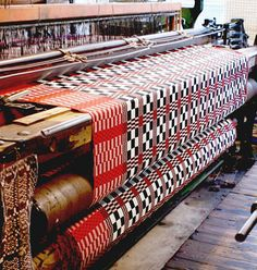 On the loom: Heritage Blanket 'Hiraeth' (Longing) by Welsh textile firm Blodwen. This double-cloth pattern (revived from a Welsh weaver's pattern book) is a bold geometric chequer-board design in two colourways (monochrome and red).
