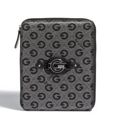"G by GUESS Dashonnie Logo Ipad Case, COAL by G by GUESS. $17.48. Secure your obsession with a trend-right case. Ipads love glitter-and they deserve to be happy. Logo-print canvas with glittery finish and patent trim. Silver-tone hardware. Logo plaque at front. Faux-leather back. Zip-around closure. Patent panels at top corners. Elasticized panels at bottom corners. Leopard-print lining 8 ½""W x 10 ½""H Handbags > Small Accessories. Save 56% Off!"