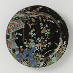 Black Delftware plate, 22,5 cm., 1710-1730, made in Delft, inventory number BK-NM-12400-267 Rijksmuseum Amsterdam, Amsterdam, The Netherlands