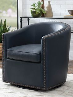 Treat yourself to a pampering getaway that's also perfect for a small space. Classic design with a 360° swivel, our exclusive Augusto chair has the perfect mix of beauty and comfort. Oversized nailheads accentuate the simple silhouette. Made with lasting quality. Swivel Glider, Swivel Chair, Bedroom Setup, Leather Club Chairs, Chair And A Half, Wing Chair, Beautiful Living Rooms, Living Room Colors, Nailhead Trim