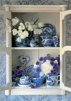 A display, even in a cute cabinet, of just blue and white dishes could be boring. Add some white and purple or blue-violet blooms and it's transformed. Blue And White China, Blue China, Deco Floral, White Cottage, White Decor, Delft, White Porcelain, My Favorite Color, Shades Of Blue
