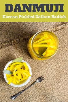 Danmuji Korean Pickled Daikon Radish Recipe Serious Eats - These Quick Korean Pickles Are Flavored With Rice Vinegar Garlic Turmeric Bay Leaves And Black Peppercorns The Turmeric Is The Key Ingredient For Getting That Bright Yellow Color Pressing A Pape # Korean Radish Recipe, Diakon Radish Recipe, Pickled Daikon Radish Recipe, Korean Pickled Radish, Pickled Radishes, Radish Recipes, Asian Recipes, Chinese Recipes, Pickling
