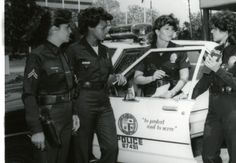 Female Police Officers are shown in front of Parker Center, the LAPD headquarters, during the 1980s.