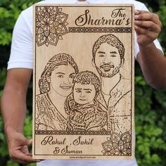 Description Family Name Custom Engraved Wooden Frame A family photo engraved with your last name and names of family members. This wood engraved photo of your family is the best personalized home decor accessory to add to the walls of your home. Let your home reflect the love shared between family members with this custom wooden wall art. This is the best personalized gift for family members. This is an ideal present for parents. Hang this wooden family wall hanging in your room or keep it on a Engraving Art, Photo Engraving, Custom Engraving, Laser Engraving, Wooden Wall Art, Wooden Frames, Laser Engraved Gifts, Wood Grain Texture, Family Wall