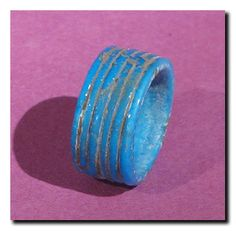 Egyptian Faience Ring, Amarna Period, 18th Dynasty, c. 1361-1352 B.C. Wide ring with incised and fluted outer surface.
