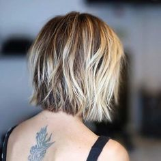 Textured, Blunt Bob Haircut with Layers and Blonde Highlights