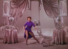 """Leslie Caron in """"An American in Paris"""". Wardrobe by: Orry-Kelly, Walter Plunkett and Irene Sharaff (Oscar winners for this movie), la robe violette très fendue Paris Movie, Paris 3, Hollywood Glamour, Classic Hollywood, Old Hollywood, Hollywood Actresses, Hollywood Fashion, Hollywood Regency, Orry Kelly"""