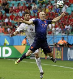 FIFA World Cup 2014 - Clash of the titans: Alonso and Arjen Robben compete for a ball in the air as the Dutchman goes flying