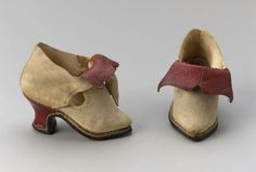 Pair of children's shoes        Italian, 1600–50         Italy  Dimensions      11.4 x 7.7 x 9 cm (4 1/2 x 3 1/16 x 3 9/16 in.)  Medium or Technique      Leather  Classification      Costumes     Accession Number      43.1729a  Not on view