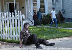 """""""Days Gone Bye"""" S1E1 ~ The Walking Dead (AMC) Duane (Adrian Kali Turner), Morgan (Lennie James) and Rick Grimes (Andrew Lincoln). Morgan and his son Duane watch Rick deal with a walker."""