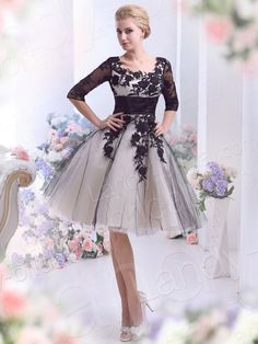 Short Tulle Black & white Wedding Dress in fun style. Would be great long or short