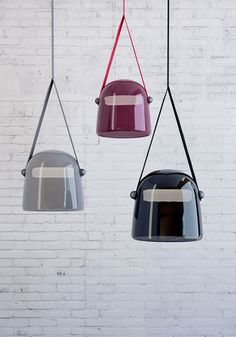 Mona by Lucie Koldova for Brokis. The bell-shaped Mona pendant lamp features a large blown glass shade supported by textile straps. Also available in a floor lamp version with a glass shade, the LED light source is fixed like a bar through the tinted glass shade.  http://media.designerpages.com/3rings/2014/07/27/mona-by-lucie-koldova-for-brokis/