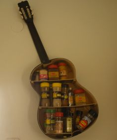 Someone has made a spice rack out of a guitar.