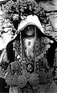 Macedonian bride from Veprchani adorned with floral wreath. Circa 1930