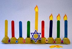 simple egg carton menorah. maybe could dress it up with a photo of kid by adding a wall to this menorah.