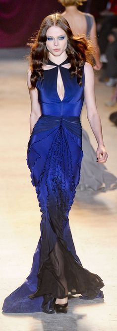 Zac Posen. I would love this with giant emerald earrings with a matching cocktail ring. Perhaps Gucci shoes and an Alexander McQueen clutch. Just saying.