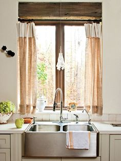 hessian curtains at the kitchen window / apron sink