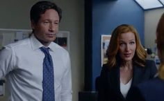 In this exclusive clip from Monday's episode of The X-Files, everyone is seeing double when Agents Miller (Robbie Amell) and Einstein (Lauren Ambrose) drop by the basement for a consultation with Mulder (David Duchovny) and Scully (Gillian Anderson).