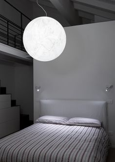 Private residence in Modena.  MOON suspension lamp and MIRA SWITCH wall lamp. By Davide Groppi