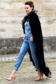 I'm loving the confidence..and of course the look [PFW: Ulyana Sergeenko jazzes up a denim-on-denim look with pastel pumps in Paris.]