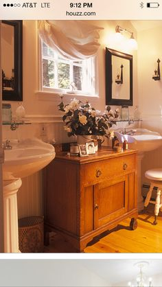 Cute bathroom! Double pedastool sinks, antique furniture for extra storage. Sweet balloon shade.