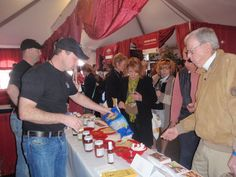 The Bone Suckin' Sauce Team working a show, luring in some tasters. Photo cred: Mary E. Phillips.